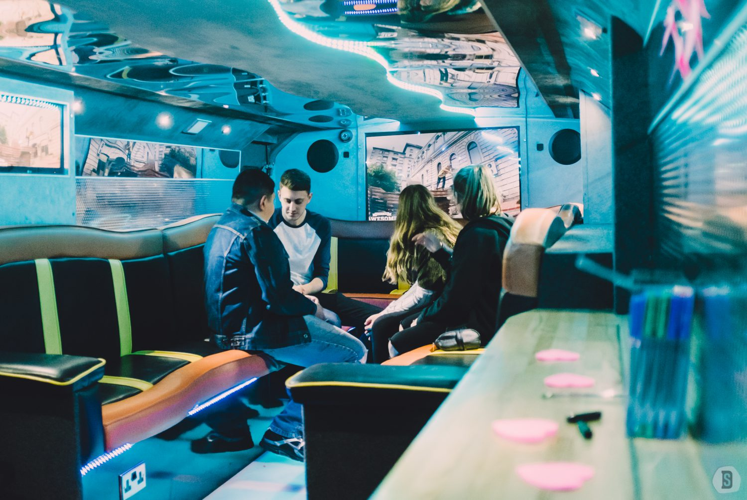 Young people watching television on the Message Bus